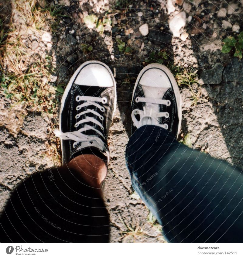 biped. Man Adults Legs Feet Fashion Clothing Pants Footwear Hip & trendy Chucks Sneakers Difference Friendship Stand Colour photo Exterior shot Day Light Shadow