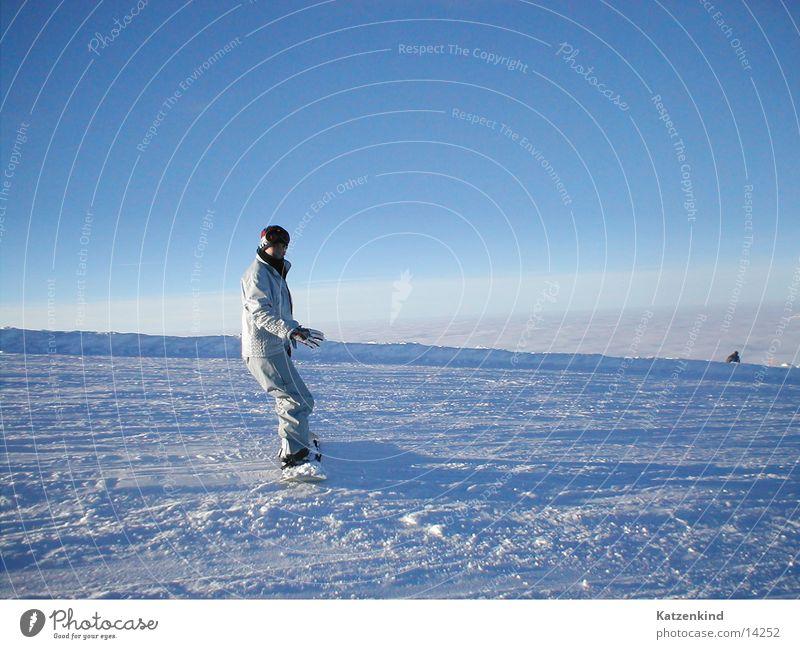 Human being Woman Sun Clouds Snow Horizon Study Beautiful weather Posture Balance Downward Caution Blue sky Snowboard Ski run Snowboarding