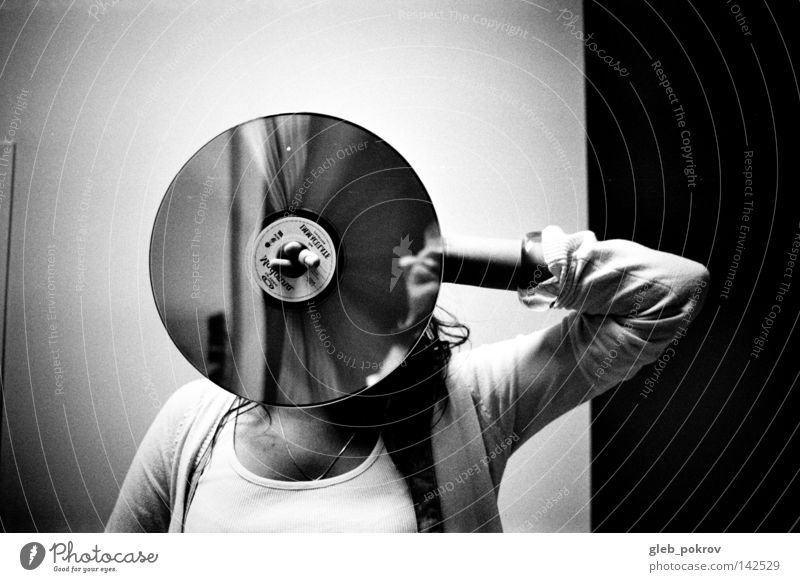 circle. Woman Human being Hand Black Wall (building) Hair and hairstyles Clothing Trash Media