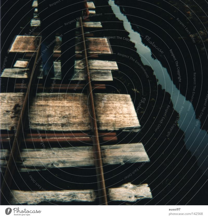 Going Transport Railroad Logistics Railroad tracks Analog Pedestrian Mountaineering Medium format Railroad tie