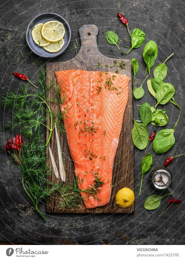 Salmon fillet on rustic chopping board with fresh ingredients Food Fish Vegetable Herbs and spices Nutrition Banquet Organic produce Vegetarian diet Diet Bowl