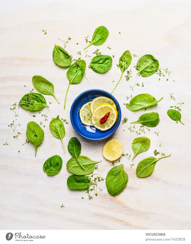Baby spinach around small bowl with lemon and spices Food Vegetable Lettuce Salad Herbs and spices Nutrition Lunch Organic produce Vegetarian diet Diet Bowl