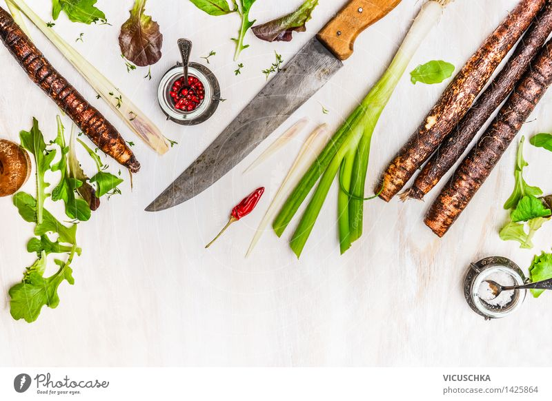 Black salsify and ingredients for cooking with a kitchen knife Food Vegetable Herbs and spices Nutrition Lunch Dinner Organic produce Vegetarian diet Diet Bowl