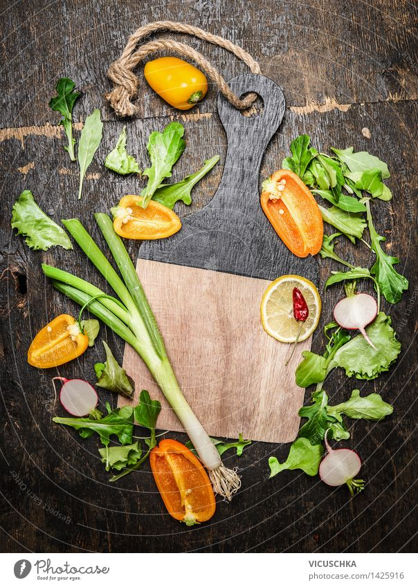 Vegetables and herbs for cooking around empty chopping board Food Lettuce Salad Herbs and spices Nutrition Lunch Organic produce Vegetarian diet Diet Lifestyle