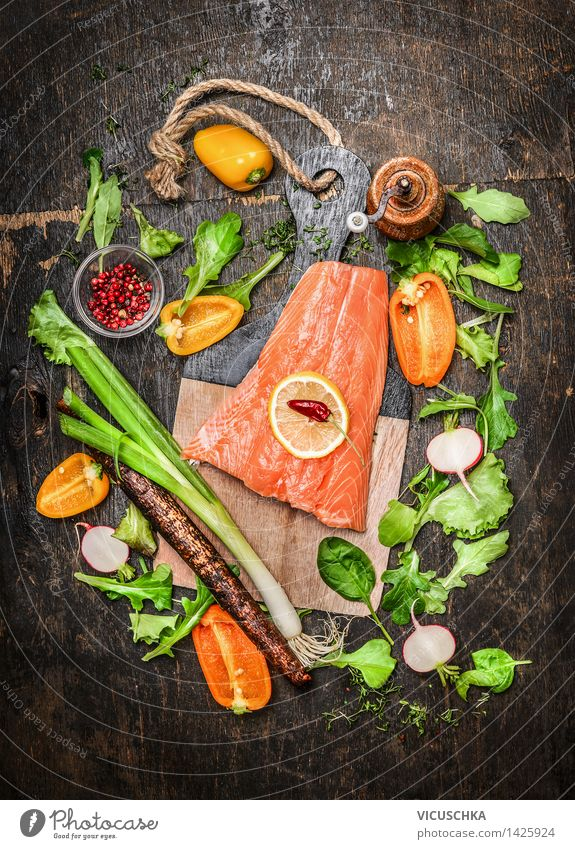 Salmon fish fillets on chopping board with fresh vegetables Food Fish Vegetable Lettuce Salad Herbs and spices Nutrition Lunch Dinner Buffet Brunch Banquet