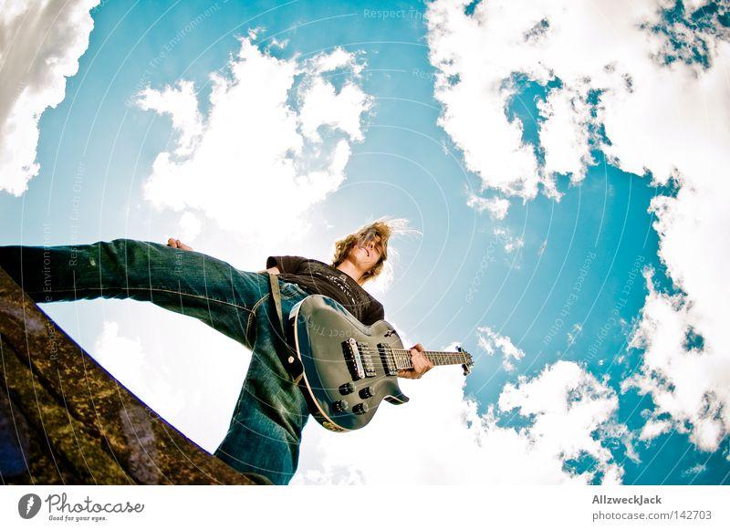 Man Sky Joy Clouds Musical instrument Music Power Action Concert Rock music Passion Wild animal Guitar Brandenburg
