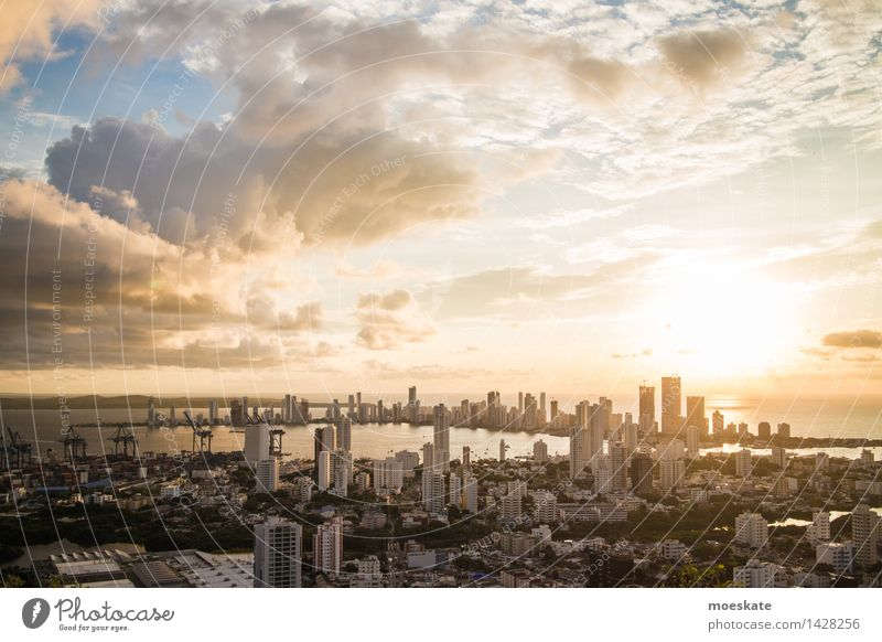 City Blue Sun Clouds House (Residential Structure) Coast Gray Horizon Gold High-rise Skyline Bank building Downtown Industrial plant Caribbean Sea Populated