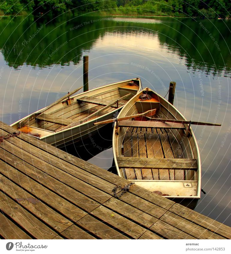 finally rest Watercraft Rowboat Calm Fishing (Angle) Vacation & Travel Lake Pond Body of water Loneliness Wood Footbridge Summer Playing reflection Evening