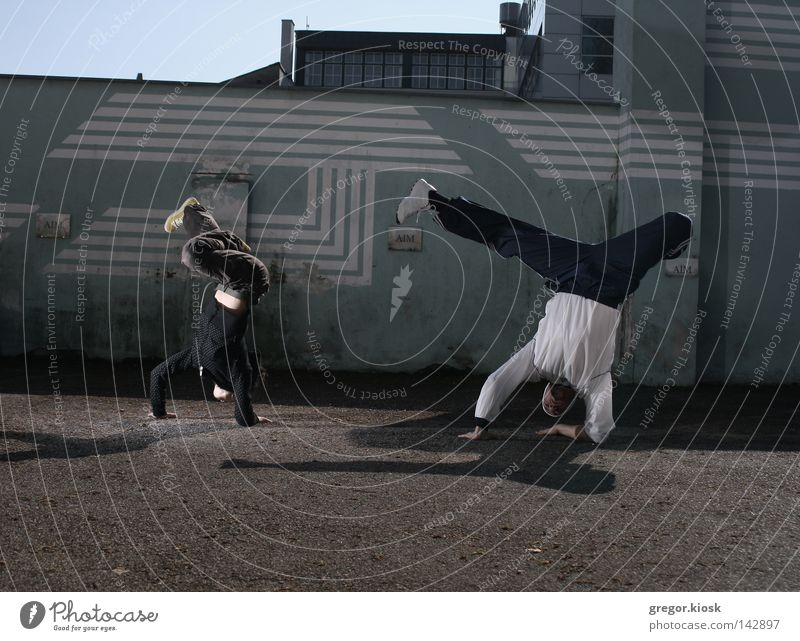 Breakdance II Woman Man Youth (Young adults) Blue City Red Black Street Wall (building) Gray Movement Bright Dance Together Fashion