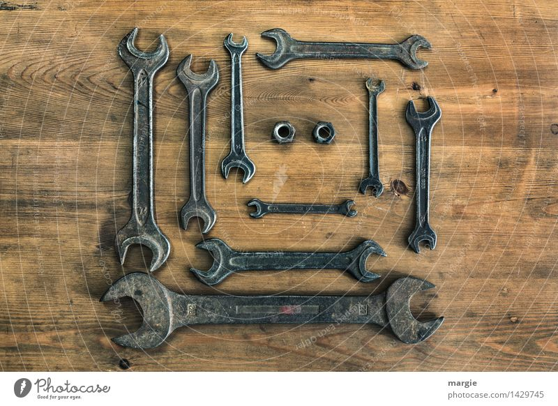 A collection of wrenches in different sizes, two nuts in landscape format Leisure and hobbies Home improvement Work and employment Profession Craftsperson