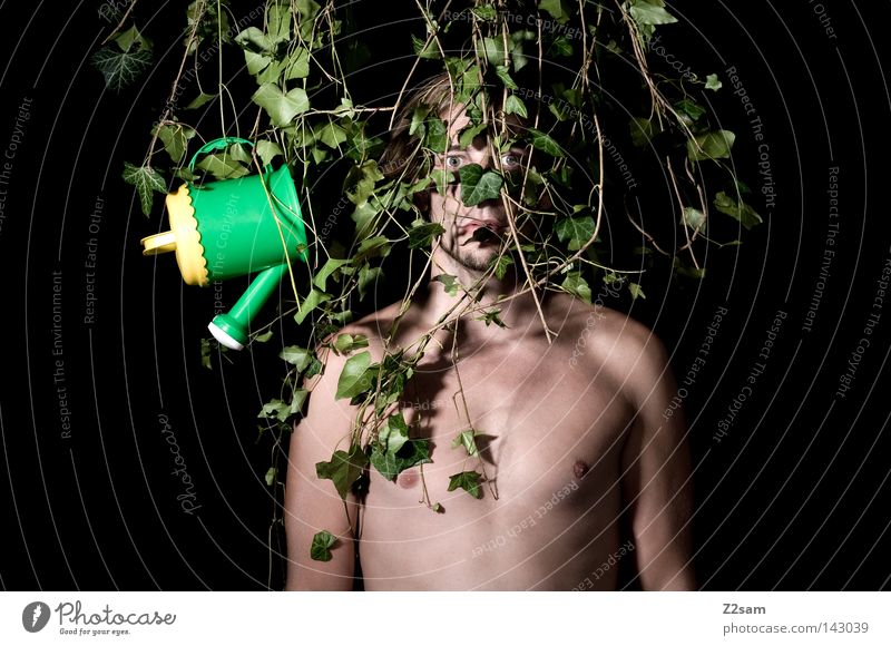 IN THE JUNGLE // Man Masculine Crazy Green Growth Captured Shackled Forest-dweller Virgin forest Stand Rooted Plant Ivy Loneliness Calm Hostage Style Botany