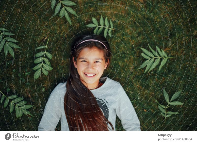 Little girl lying on the grass and smile Human being Child Green Beautiful Summer Girl Face Eyes Yellow Love Funny Happy Laughter Small School Lie