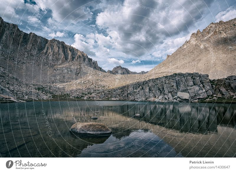 Sky Nature Summer Relaxation Landscape Clouds Calm Far-off places Mountain Environment Freedom Lake Rock Weather Contentment Tourism