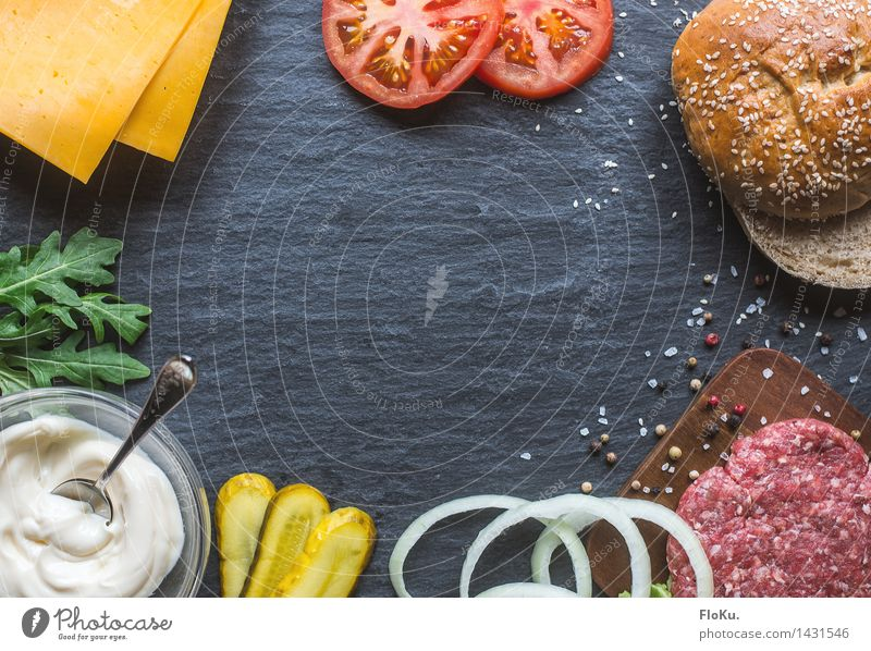We're building ourselves a burger. Food Meat Cheese Vegetable Lettuce Salad Dough Baked goods Roll Herbs and spices Nutrition Lunch Dinner Fast food Cook