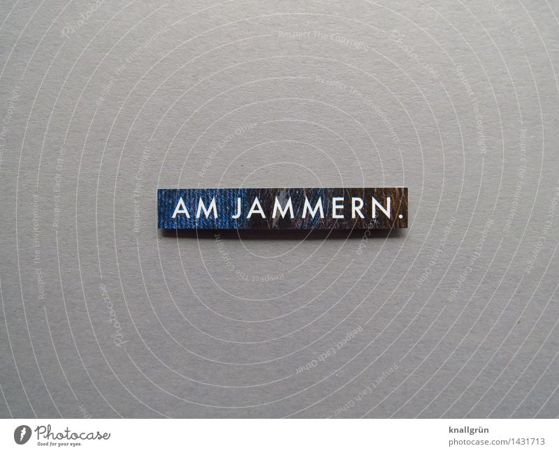 JAMMER. Characters Signs and labeling Communicate Sharp-edged Blue Gray Emotions Moody Reluctance Frustration Distress Grumble Sadness Colour photo Studio shot
