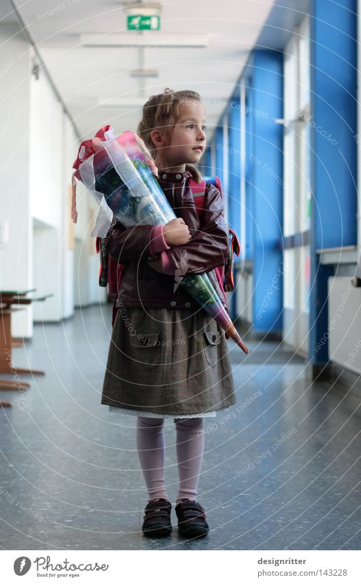 What do we do now? Child Girl School building Student Schoolchild First day at school Beginning Education Expectation Curiosity PISA study Maturing time