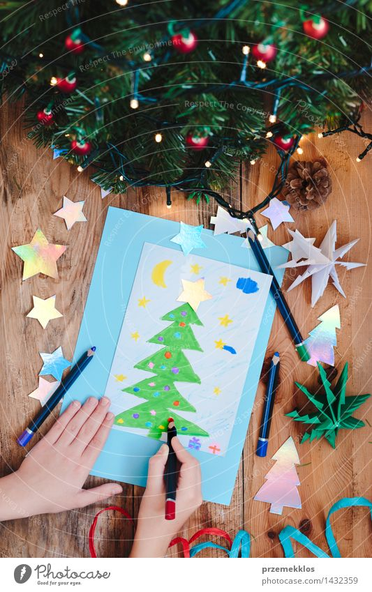 Girl drawing Christmas card with pine tree Human being Christmas & Advent Tree Hand Wood Decoration Vantage point Table Creativity Paper Illustration Card Top