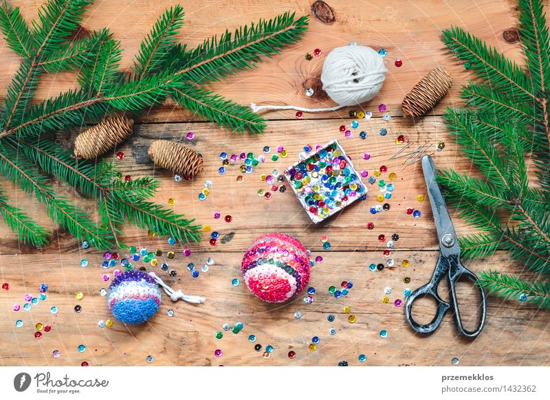 Making Christmas ball pinning the sequins onto the ball Handcrafts Decoration Table Christmas & Advent Scissors Wood Ornament Creativity christmas colorful