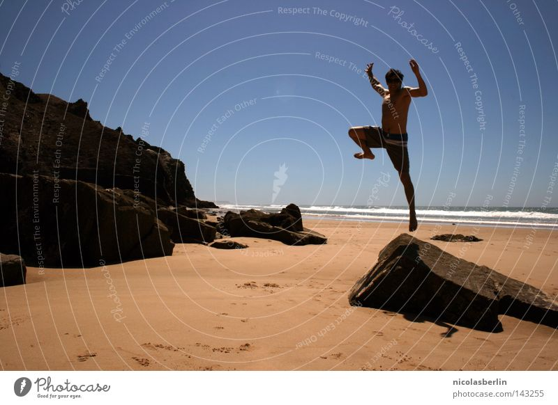 Man Sky Ocean Blue Beach Black Relaxation Jump Happy Stone Emotions Sand Success Rock Tall Action