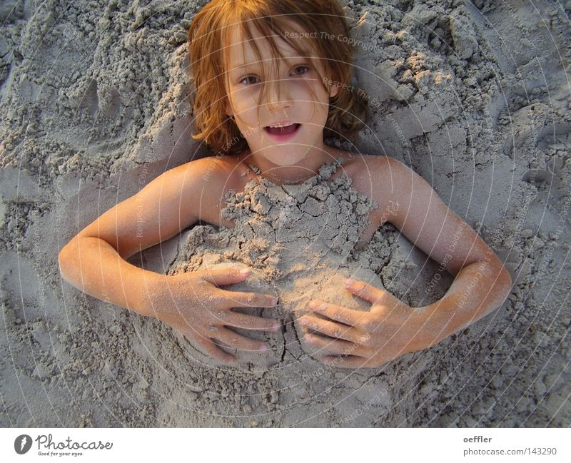 sand hill Child Sand Joke Funny Breasts Slapstick Portrait photograph Face of a child Funster Looking into the camera