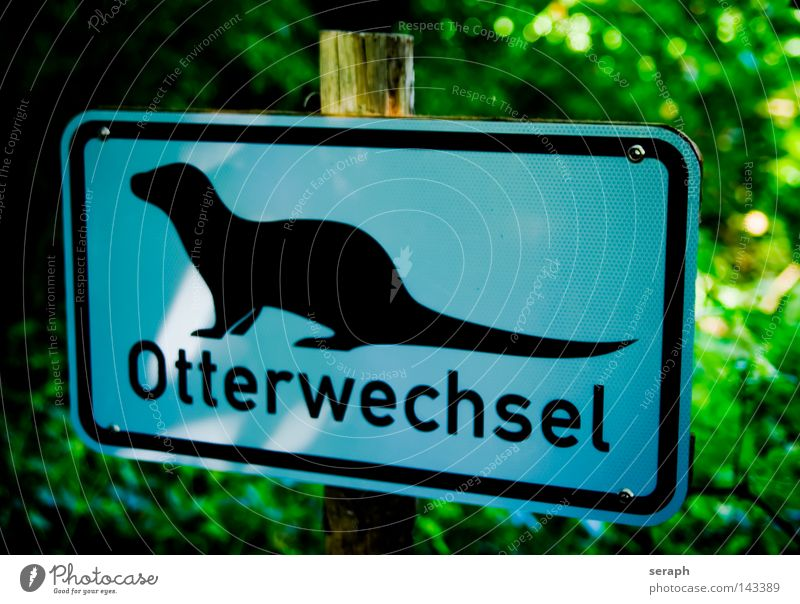 Otter Pictogram Symbols and metaphors Street sign Road sign Information Signage Rectangle Graphic Letters (alphabet) Typography Tin plate sign Strange