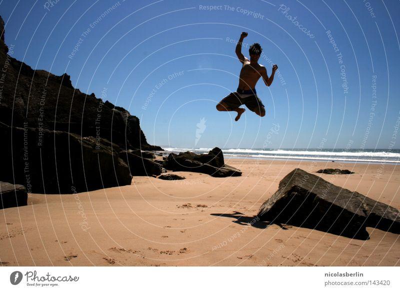 Man Sky Ocean Blue Joy Beach Black Relaxation Jump Happy Stone Sand Success Rock Tall Action