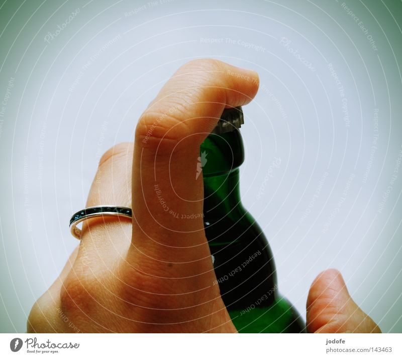 confiscated. Hand Fingers Bottle of beer Ring To hold on Closed Bottle lid Forefinger Thumb Human being Green Glass Alcoholic drinks Consumption