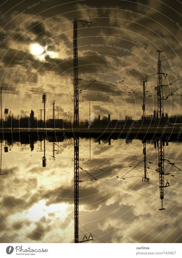 Atlantis HBf Apocalypse Platform Rush hour Commuter Puddle Reflection Back-light Overhead line Electricity Railroad tracks Clouds Dramatic Threat Dark Lateness