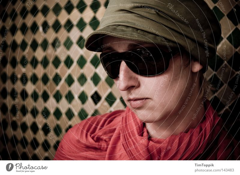 Operation Marrakech Woman Portrait photograph Cap Baseball cap Scarf Neckerchief Sunglasses Eyeglasses Wall (building) Mosaic Near and Middle East Morocco Agent