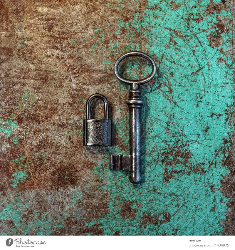 An unequal pair in Q-format: small lock with large key on rusty metal Work and employment Profession Craftsperson Workplace Construction site Tool Technology