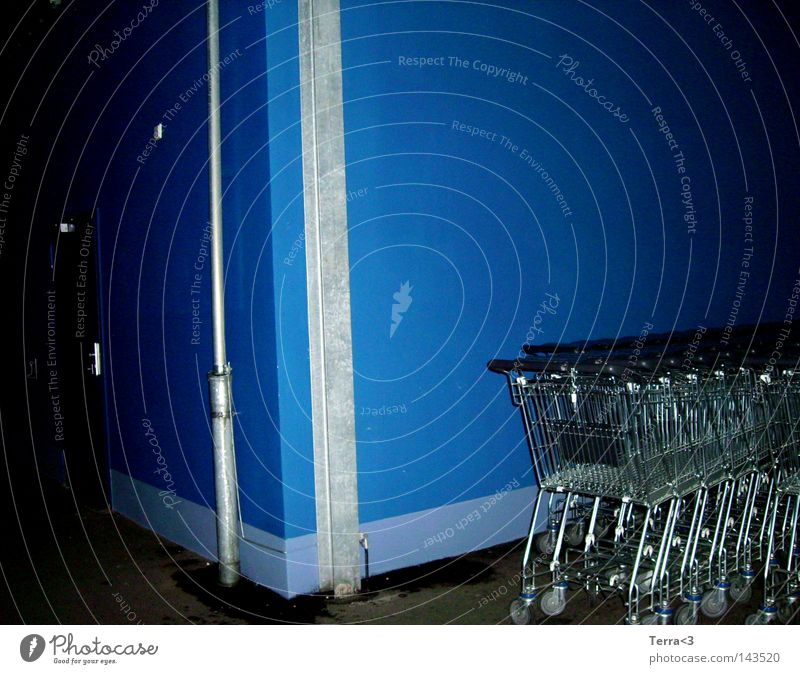 Blue. Store premises Wall (building) Dark Dirty Shopping Trolley Roll Push Shopping basket Slit Night 3 Metal Metalware Iron-pipe Door Safety Closed Joy