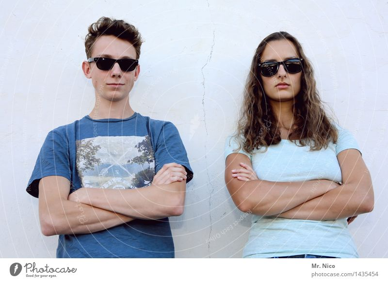junior doorkeeper Lifestyle Young woman Youth (Young adults) Young man Arm 2 Human being Wall (barrier) Wall (building) Sunglasses Brunette Short-haired