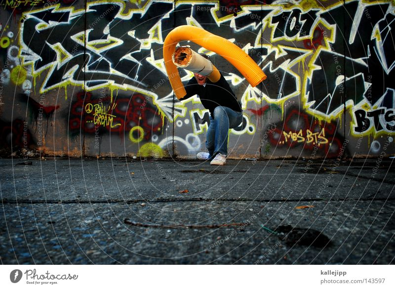Human being Man Hand City Yellow Graffiti Wall (building) Style Wild animal Arm Concrete Crazy Future Railroad tracks Pain Force