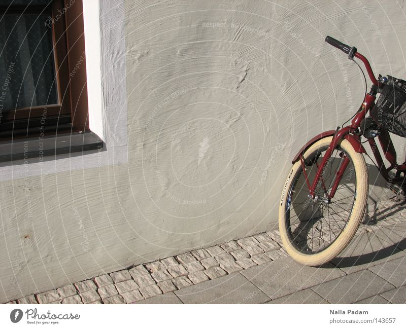 parking position Colour photo Exterior shot Deserted Day Shadow Deep depth of field Bicycle Wall (barrier) Wall (building) Window Transport Bright Hip & trendy