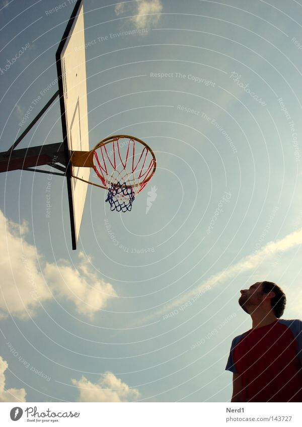 Sky Man Blue Clouds Sports Playing Air Basket Basketball Section of image Partially visible Basketball basket Light blue Basketball player Bright background