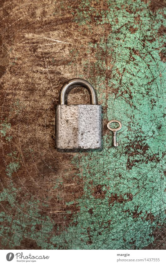 Large lock with small key in portrait format Work and employment Profession Craftsperson Services Craft (trade) Construction site Technology Metal Lock Key