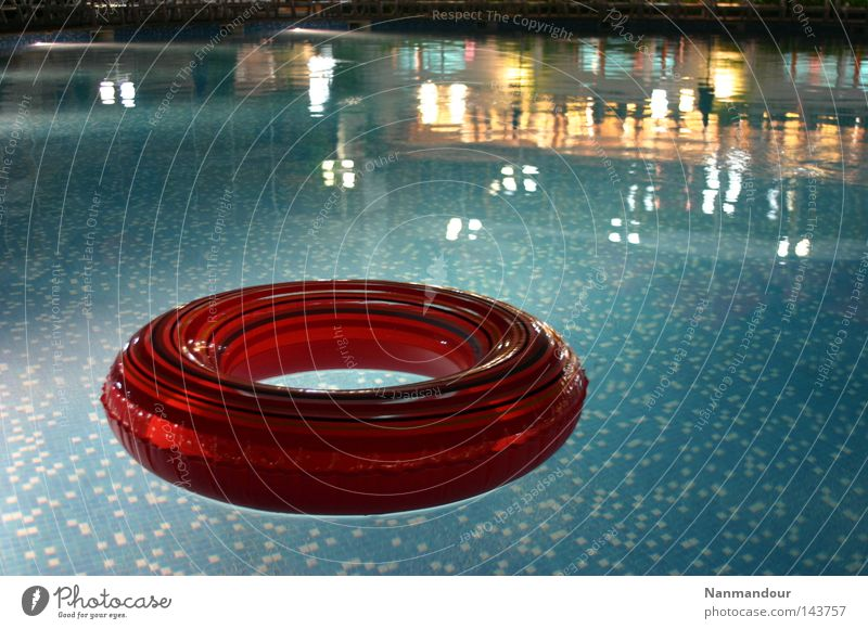 Water Calm Playing Bright Leisure and hobbies Swimming & Bathing Swimming pool Float in the water Tire Water wings
