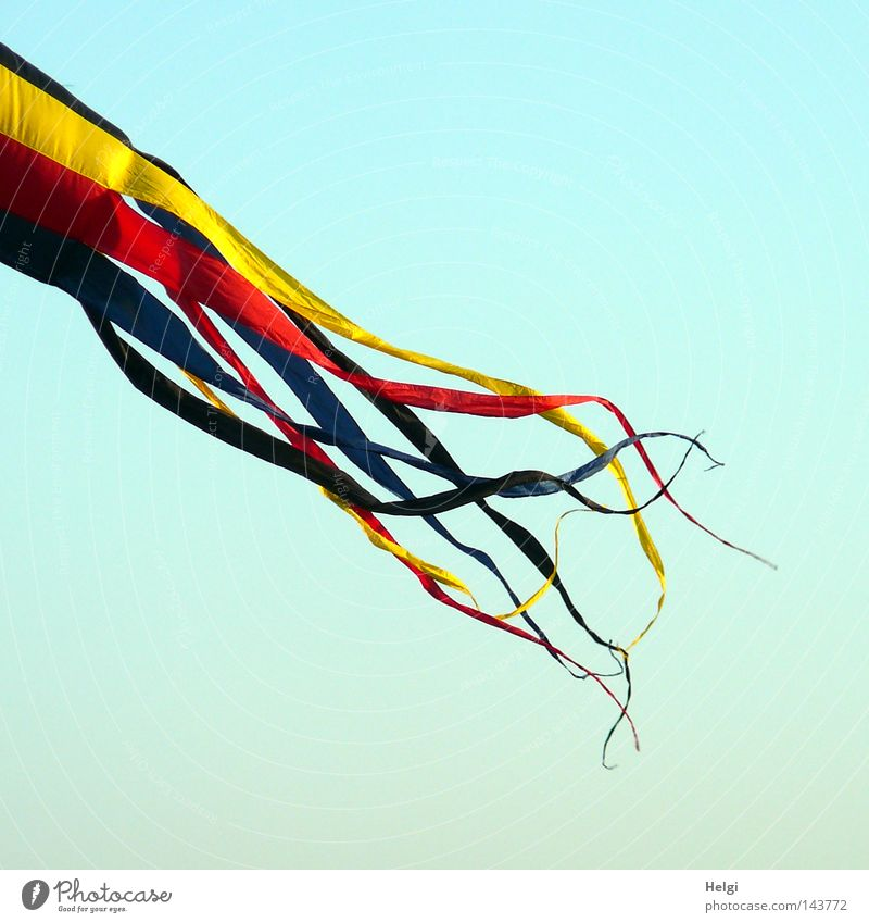 Fluttering ribbons in front of a blue sky Kite Flying Judder Unreliable Kite festival Upward Above Wind String Blow Thin Point Multicoloured Red Yellow Blue