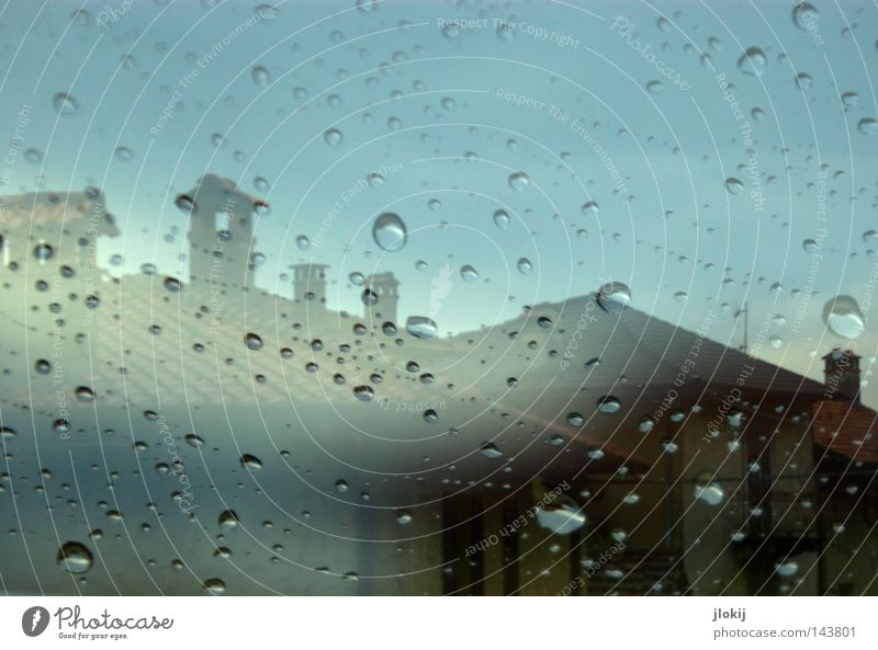 Whenever it rains... Rain Drops of water Round Wet Weather Window pane Car Window Slice Transparent Fog Movement Double exposure House (Residential Structure)