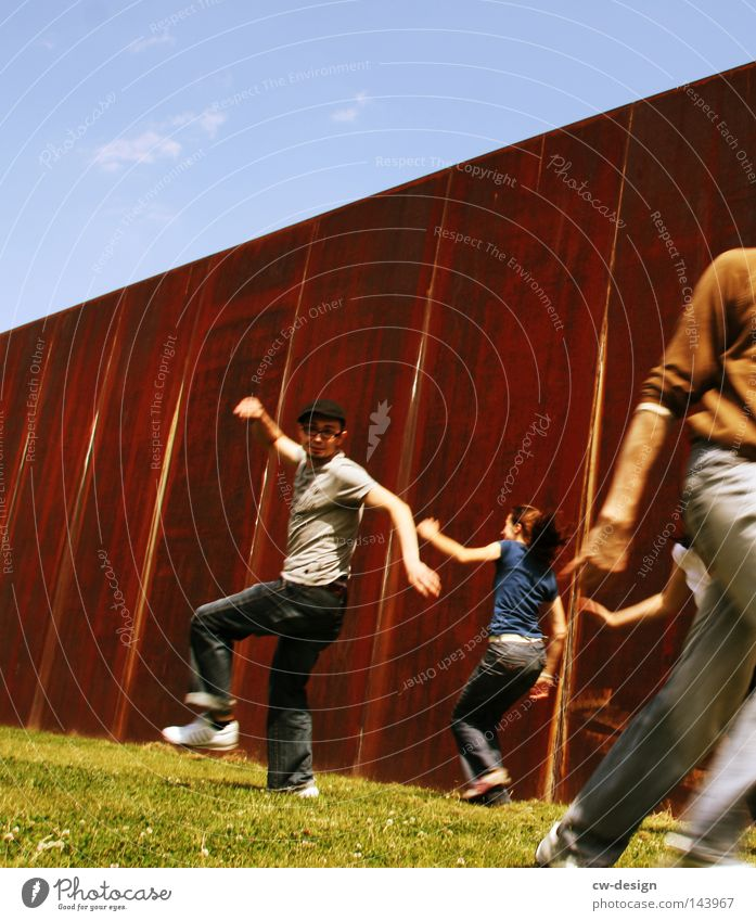 WE'VE GOT REASON TO BE HAPPY. Human being 4 3 2 Man Woman Grass Grass surface Running Playing Playground Wall (building) Rust Steel Contrast Crazy Walking