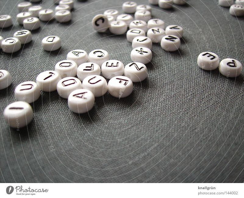 muddle Latin alphabet Letters (alphabet) Capital letter White Black Gray Round Word Thought Characters Obscure Pearl alphabet beads Write Jump sentences