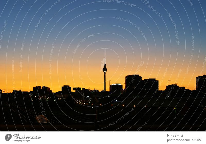 Heaven rich. Berlin Capital city Silhouette Town Back-light Sky House (Residential Structure) High-rise Berlin TV Tower Television tower Railroad Sunset Dusk