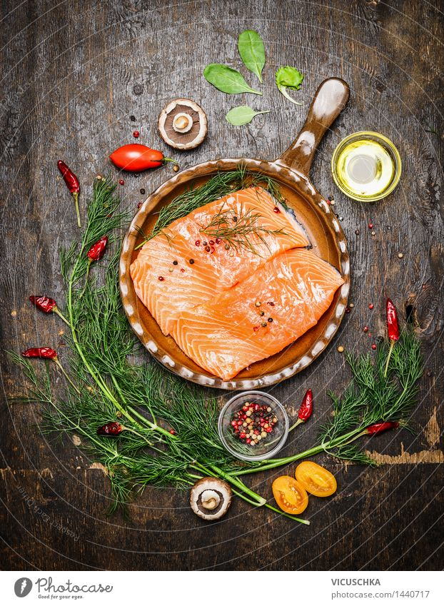 Salmon fillet with herbs in an old frying pan Food Fish Vegetable Herbs and spices Cooking oil Nutrition Lunch Dinner Buffet Brunch Banquet Organic produce