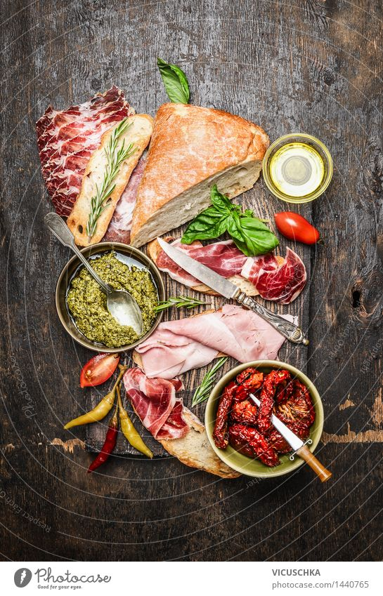 Italian meat platter with antipasti and ciabatta bread Food Meat Sausage Vegetable Herbs and spices Cooking oil Nutrition Buffet Brunch Picnic Italian Food Bowl