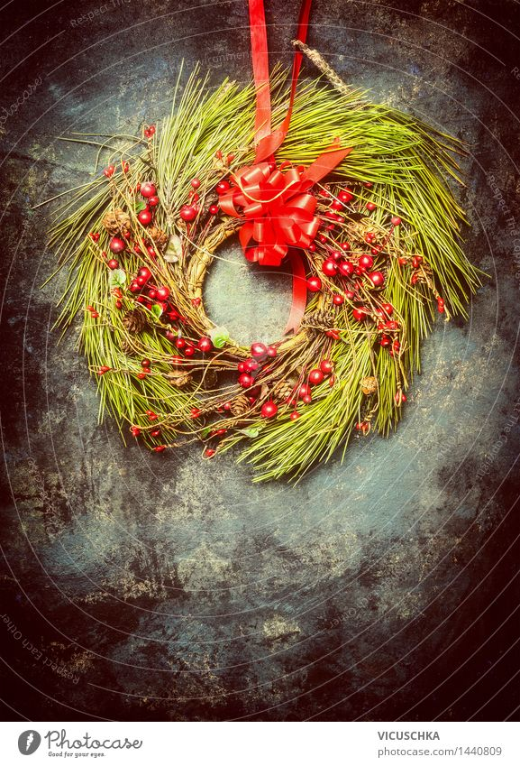 Christmas wreath made of fir branches and red winter berries Style Design Winter House (Residential Structure) Decoration Feasts & Celebrations