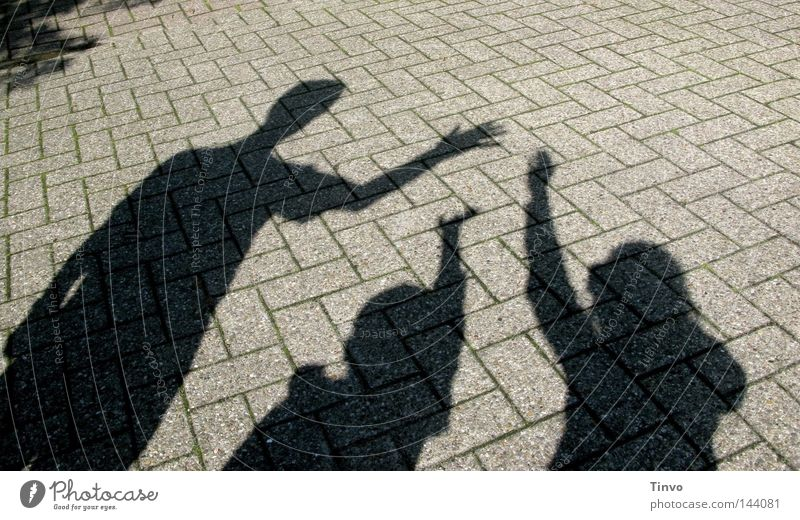 Child Man Hand Black Group Gray Family & Relations Together Arm Concrete Fingers 3 Bushes Ground Sidewalk Shadow