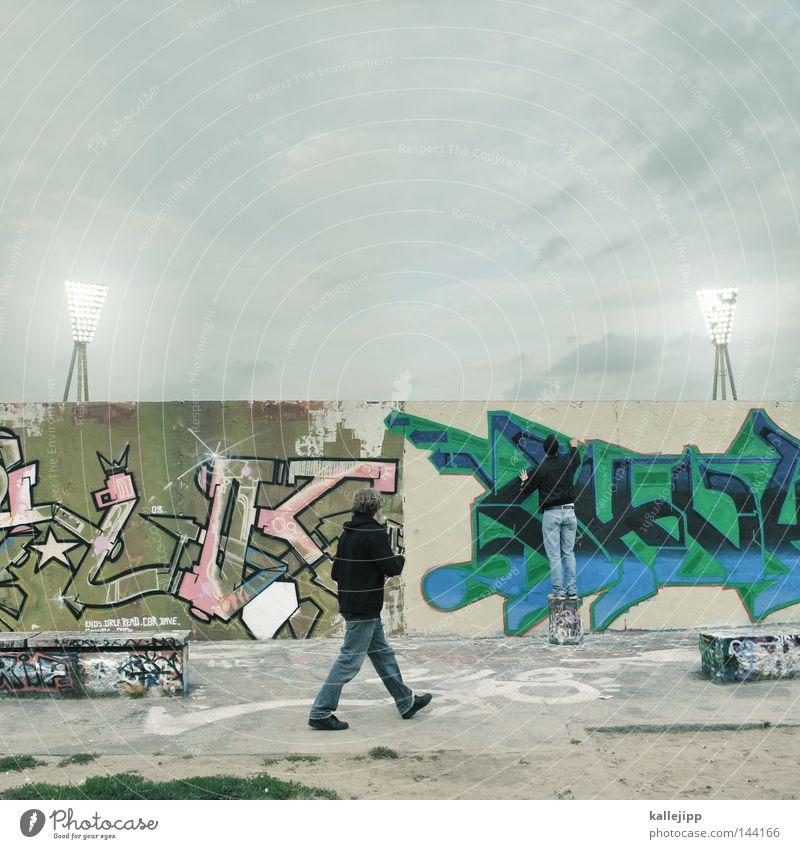 spray of light Wall (building) Wall (barrier) Prenzlauer Berg The Wall Inscription Stadium Floodlight Playing Town Shabby Man Pedestrian Human being Vandalism