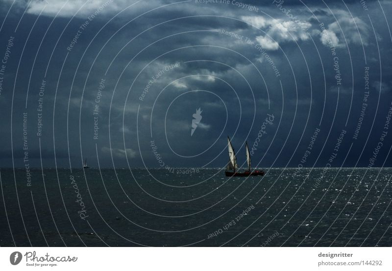 Water Sky Ocean Green Blue Clouds Far-off places Life Dark Work and employment Lake Air Watercraft Bright Waves Fear