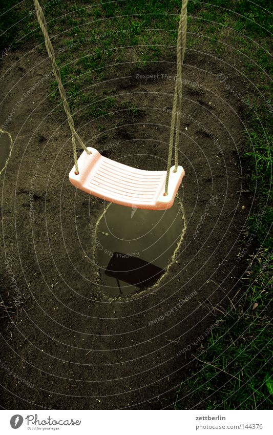 Swing in Lobbe/Rügen Playground Hang Empty Deserted Rain Puddle Demography Derelict Leisure and hobbies Relaxation confinement to one's room childlessness
