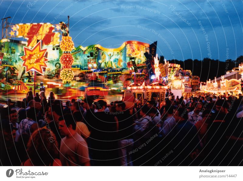 cotton candy centrifuge Fairs & Carnivals Theme-park rides Summer Multicoloured Leisure and hobbies Group Evening Human being